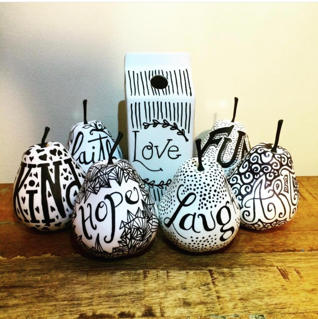 Hand lettered ceramic pears  and milk carton using ink.